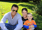 "General Hospital's Scott Reeves ""Dr. Steven Lars-Webber"" is the Celebrity Grand Marshal sitting on the curb waiting for the parade to start pose with  Beth and son Ethan at the 33rd Annual Mountain State Apple Harvest Festival (MSAHF) 2012 parade on October 20, 2012 as well as attending the Bob Elmer Celebrity Sports Breakfast sponsored by the Rotary Club and the Queen's Grand Ball at the Historic Shenandoah Hotel.  (Photo by Sue Coflin/Max Photos)"