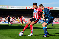 Lincoln City's Tyler Walker vies for possession with Bristol Rovers' Tony Craig<br /> <br /> Photographer Chris Vaughan/CameraSport<br /> <br /> The EFL Sky Bet League One - Lincoln City v Bristol Rovers - Saturday 14th September 2019 - Sincil Bank - Lincoln<br /> <br /> World Copyright © 2019 CameraSport. All rights reserved. 43 Linden Ave. Countesthorpe. Leicester. England. LE8 5PG - Tel: +44 (0) 116 277 4147 - admin@camerasport.com - www.camerasport.com