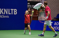 December 18, 2014, Rotterdam, Topsport Centrum, Lotto NK Tennis, ballgirl catches towel<br /> Photo: Tennisimages/Henk Koster