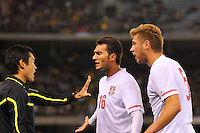 MELBOURNE, AUSTRALIA - JUNE 7: Ivan Obradovic and Slobodan Rajkovic of Serbia argue with the linesman during an international friendly match between the Qantas Australian Socceroos and Serbia at Etihad Stadium on June 7, 2011 in Melbourne, Australia. Photo by Sydney Low / AsteriskImages.com