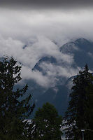 Clouds above the mountains over Mount Seymour provincial park. Deep Cove, Burrard Inlet, Vancouver, British Columbia, Canada.