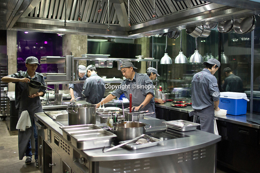 Kitchine work at the Ultraviolet restaurant in Shanghai, China on 27th Sept 2013.  The restaurant in run by Chef Paul Pairet. <br /> <br /> Photo by Qilai Shen / Sinopix