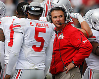 Ohio State Buckeyes head coach Urban Meyer talks to quarterback Braxton Miller (5) on the sideline during the second half of the NCAA football game at Ross-Ade Stadium in West Lafayette, Ind. on Nov. 2, 2013. (Adam Cairns / The Columbus Dispatch)