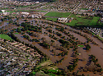 January 3, 1997--1997 Flood--Dryden Golf Course.  A series of subtropical storms, collectively called a pineapple express, struck northern California from late December 1996 to early January 1997.  December 1996 was one of the wettest Decembers on record.  For the first time since its completion in 1971, water began spilling over the dam at Don Pedro Reservoir in western Tuolumne County on Thursday. This caused a dramatic rise of the Tuolumne River and Dry Creek in Stanislaus County. Early Friday morning, the level of the Tuolumne River in Modesto reached 55 feet, which is flood stage. Unfortunately, the river continued to rise rapidly all afternoon, reaching an astonishing 70 feet by late Friday evening.   One neighborhood along Dry Creek just east of downtown Modesto was under as much as 15 feet of water, as were neighborhoods along the Tuolumne River in southwest Modesto.<br /> Photo by Al Golub/Modesto Bee