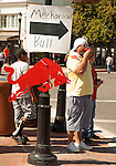 """Signs point the crowds toward the """"Mechanical Bull"""" in downtown Pittsburg during the 29th annual Pittsburg Seafood and Music Festival on Sunday, September 8th, 2013 in Pittsburg, California.  Photo/Victoria Sheridan."""