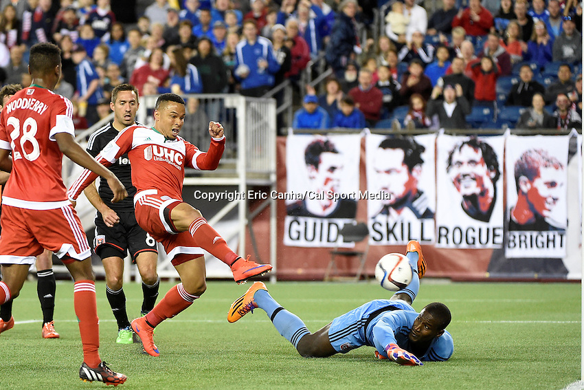 May 23, 2015 - Foxborough, Massachusetts, U.S. - New England Revolution forward Charlie Davies (9) shoots the ball by D.C. United goalkeeper Bill Hamid (28) and scores in the first period of the MLS game between DC United and the New England Revolution held at Gillette Stadium in Foxborough Massachusetts. Eric Canha/CSM