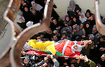 "Mourners carry the body of Palestinian Ahmad Najjar, 20, who was shot dead by Israeli soldiers, during his funeral in the West Bank village of Burin near Nablus February 1, 2015. Israeli soldiers shot dead Najjar on Saturday in the occupied West Bank, the military and a Palestinian security official said. An Israeli military spokeswoman said soldiers saw two Palestinians throwing a fire bomb towards a road near the Palestinian city of Nablus and ""identifying an immediate threat shot toward the suspects' lower extremities"". A Palestinian security source said one of the Palestinians shot by the soldiers was killed, but gave no further details. The Israeli military said it was searching for the second man. Photo by Nedal Eshtayah"