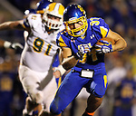 BROOKINGS, SD - SEPTEMBER 14:  Zach Zenner #31 from South Dakota State University weaves his way past the defense of Southeastern Louisiana in the fourth quarter of their game Saturday night at Coughlin Alumni Stadium in Brookings. (Photo by Dave Eggen/Inertia)