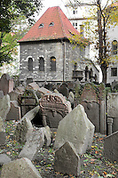 "Tombstones in the Old Jewish Cemetery, dating from 1439 to 1787, in the Josefov or Jewish Quarter of Prague, Czech Republic. The original cemetery was called ""The Jewish Garden"" and was excavated under the Vladislavova street, New Town. Because Jewish graves cannot be moved, when the cemetery became full, more earth was put on top and the tombstones shuffled up, until there were 12 layers of tombs and approximately 12,000 tombstones presently visible, although there may be as many as 100,000 burials in all. Those buried here include Yehuda ben Bezalel or the Maharal Rabbi Low (d. 1609), Mordechai Maisel (d. 1601), David Gans (d. 1613) and David Oppenheim (d. 1736). The historic centre of Prague was declared a UNESCO World Heritage Site in 1992. Picture by Manuel Cohen"