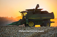 63801-06801 John Deere combine harvesting corn at sunset, Marion Co., IL