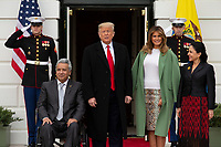 United States President Donald J. Trump, left center, and First lady Melania Trump, right center, stand for a photo with the President of Ecuador Lenín Moreno, left, and his wife Rocio Gonzales De Moreno outside the White House in Washington D.C., U.S. on Wednesday, February 12, 2020.  <br /> <br /> Credit: Stefani Reynolds / CNP/AdMedia