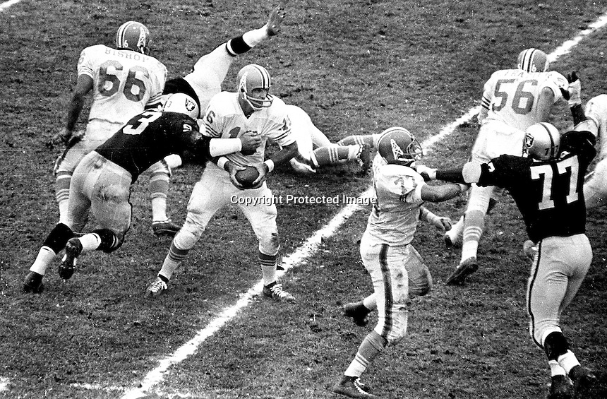 Oakland Raiders playing Houston.. Oilers QB George Blanda is about to get sacked by Dan Birdwell, Ike Lassiter #77. (1966-67 photo by Ron Riesterer)