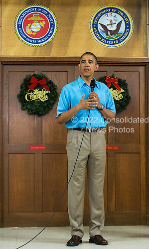 United States President Barack Obama makes remarks as he and first lady Michelle Obama (not pictured) greet military personnel eating Christmas dinner at Anderson Hall at Marine Corps Base Hawaii on December 25, 2012 in Kaneohe Bay, Hawaii.  .Credit: Kent Nishimura / Pool via CNP