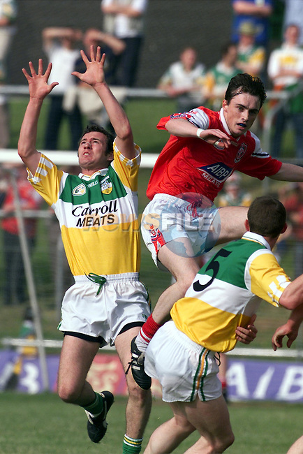 Louth's Simon Gerard  and Offaly's Gary Comerford in action in thier match at Pairc tailteann in Navan..Picture: Paul Mohan/Newsfile