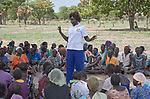 Nurse Mary Adut Muorde talks with local villagers at a community meeting about health on the grounds of the Loreto School outside Rumbek, South Sudan. The school is run by the Institute for the Blessed Virgin Mary--the Loreto Sisters--of Ireland. Muorde is a graduate of the Catholic Health Training Institute in Wau, South Sudan.