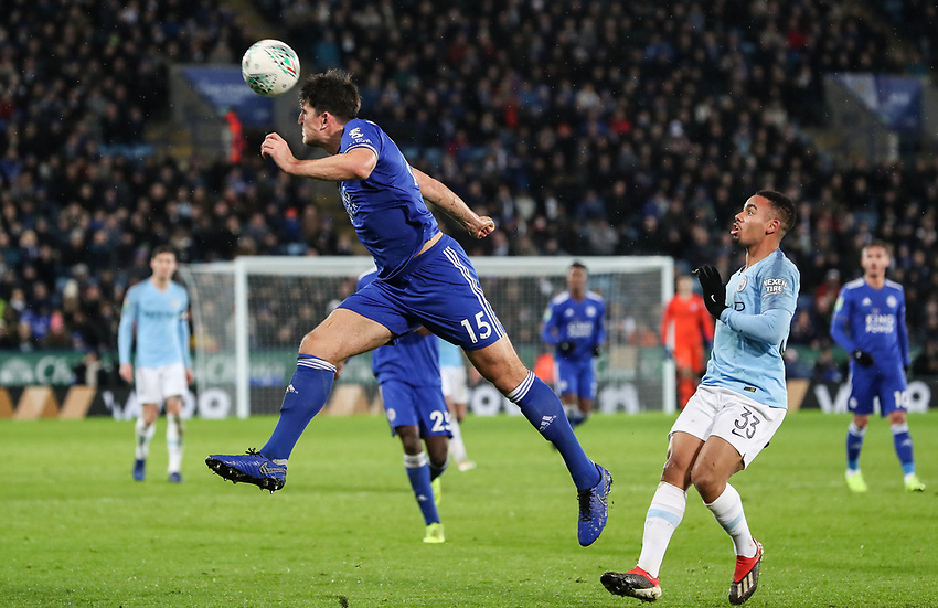 Manchester City 's Gabriel Jesus looks on as Leicester City 's Harry Maguire heads clear<br /> <br /> Photographer Andrew Kearns/CameraSport<br /> <br /> English League Cup - Carabao Cup Quarter Final - Leicester City v Manchester City - Tuesday 18th December 2018 - King Power Stadium - Leicester<br />  <br /> World Copyright © 2018 CameraSport. All rights reserved. 43 Linden Ave. Countesthorpe. Leicester. England. LE8 5PG - Tel: +44 (0) 116 277 4147 - admin@camerasport.com - www.camerasport.com