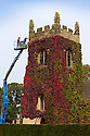 19/09/14 <br /> <br /> Time for an Indian summer trim - estate workers, Aiden Linton and Robert Austin give the virginia creeper its annual trim on the old parish church at Okeover, near Ashbourne, in the Derbyshire Peak district. The warm and dry weather in the last few weeks has helped the colours to be more vibrant than they have for many years. All this year's new growth is pruned to protect the church's stonework and to stop the church disappearing altogether.<br /> <br /> All Rights Reserved: F Stop Press Ltd. +44(0)1335 300098   www.fstoppress.com.