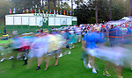 AUGUSTA, GA - APRIL 11:  Golf Fans enter the front gate at 7am to take their places on the golf course before the first tees during the First Round of the 2013 Masters Golf Tournament at Augusta National Golf Club on April 10in Augusta, Georgia. One of the most prized tickets for golf fans, and it is estimated that the Masters tournament brings more than 250,000 people and $100 million USD of revenue into Augusta.