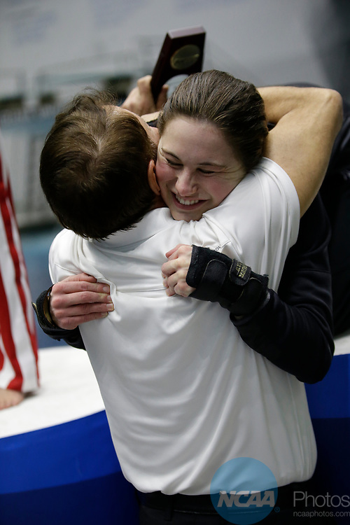 INDIANAPOLIS, IN - MARCH 18: Olivia Rosendah hugs her Northwestern coach Alik Sarkisian after winning the platform diving title during the Division I Women's Swimming & Diving Championships held at the Indiana University Natatorium on March 18, 2017 in Indianapolis, Indiana. (Photo by A.J. Mast/NCAA Photos via Getty Images)