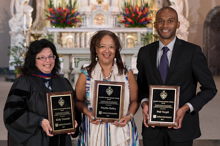 Left to right, Kelly Tzoumis, Phyllis Bailey, and Phil Verpil were presented with Gerald Paetsch Academic Advising Awards during DePaul's annual Academic Convocation at the St. Vincent de Paul Parish Church Thursday, Aug. 31, 2017. A. Gabriel Esteban, Ph.D., president of DePaul University, presented the awards to faculty and staff. (DePaul University/Jeff Carrion)