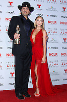 PASADENA, CA - SEPTEMBER 27: Director Robert Rodriguez and Actress Alexa Vega pose in the press room during the 2013 NCLR ALMA Awards held at Pasadena Civic Auditorium on September 27, 2013 in Pasadena, California. (Photo by Xavier Collin/Celebrity Monitor)