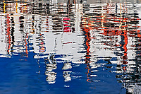 Boats at a harbor are reflected in ripping water at a harbor in Honolulu, O'ahu.