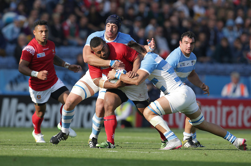 Tonga's Elvis Taione is tackled by Argentina's Pablo Matera (right) and Agustin Creevy (left)<br /> <br /> Photographer Stephen White/CameraSport<br /> <br /> Rugby Union - 2015 Rugby World Cup Pool C - Argentina v Tonga - Sunday 4th October 2015 - King Power Stadium - Leicester <br /> <br /> &copy; CameraSport - 43 Linden Ave. Countesthorpe. Leicester. England. LE8 5PG - Tel: +44 (0) 116 277 4147 - admin@camerasport.com - www.camerasport.com
