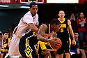 29 February 2012: Toney McCray #0 of the Nebraska Cornhuskers reaches around Melsahn Basabe #1 of the Iowa Hawkeyes trying to get the ball away at the Devaney Sports Center in Lincoln, Nebraska. Iowa defeated Nebraska 62 to 53.