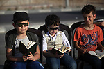 Palestinian children read verses of holy Quran during an Quran chain organised on the beach of Gaza city, on May 29, 2019. About 1050 Quran students take part in the event during the holy fasting month of Ramadan. Photo by Mahmoud Ajjour