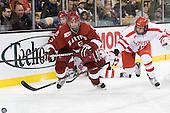 Ryan Grimshaw (Harvard - 6), Dan Ford (Harvard - 5), Matt Nieto (BU - 17) - The Harvard University Crimson defeated the Boston University Terriers 5-4 in the 2011 Beanpot consolation game on Monday, February 14, 2011, at TD Garden in Boston, Massachusetts.