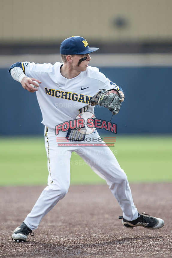 Michigan Wolverines third baseman Blake Nelson (10) makes a throw to first base against the Maryland Terrapins on April 13, 2018 in a Big Ten NCAA baseball game at Ray Fisher Stadium in Ann Arbor, Michigan. Michigan defeated Maryland 10-4. (Andrew Woolley/Four Seam Images)