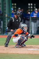 Virginia Cavaliers catcher Matt Thaiss (21) sets a target as home plate umpire Greg Howard looks on during the game against the Seton Hall Pirates at The Ripken Experience on February 28, 2015 in Myrtle Beach, South Carolina.  The Cavaliers defeated the Pirates 4-1.  (Brian Westerholt/Four Seam Images)