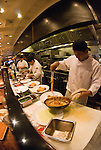Cooks prepare meals in a San Francisco restaurant