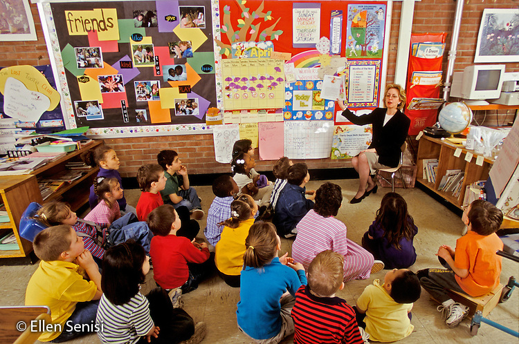 MR / Schenectady, NY.Zoller Public School - Inclusion Class - Grade 1.Female Principal reads story to class (group includes non-Special ED, non-native speaker, ADHD, cerebral palsy, spina bifida students).MR: MF.PN#: 28403                     FC#: 27304-00216.scan from slide.©Ellen B. Senisi