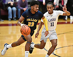 Collinsville guard Cawhan Smith (right) keeps pace with OFallon guard Caleb Burton. Collinsville played OFallon in a Class 4A Pekin boys basketball sectional semifinal game at Belleville West High School in Belleville, Illinois on Tuesday March 10, 2020. <br /> Tim Vizer/Special to STLhighschoolsports.com