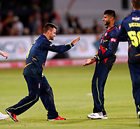 Imran Qayyum (R) is congratulated by Heino Kuhn after taking the wicket of Alex Davies during the T20 Quarter-Final game between Kent Spitfires and Lancashire Lightning at the St Lawrence ground, Canterbury, on Aug 23, 2018.