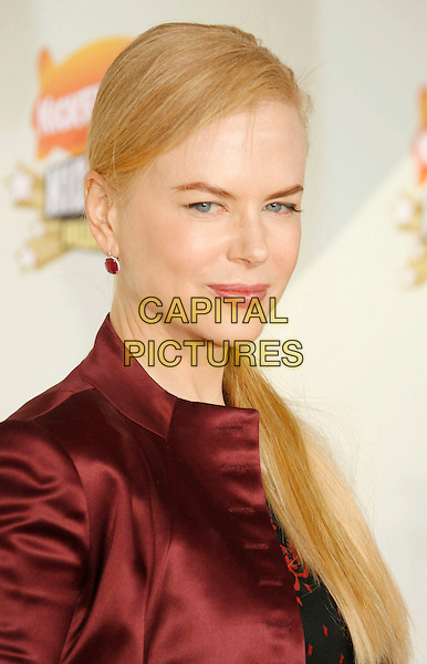 NICOLE KIDMAN .20th Annual Nickelodeon Kids' Choice Awards held at UCLA's Pauley Pavilion, Westwood, California, USA,.31 March 2007..portrait headshot red maroon jacket earrings side ponytail.CAP/ADM/RE.©Russ Elliot/AdMedia/Capital Pictures.