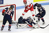 Sarah MacDonnell (UConn - 26), Alexandra Garcia (UConn - 83), Jenn Wakefield (BU - 9), Maggie Walsh (UConn - 28) - The Boston University Terriers defeated the visiting University of Connecticut Huskies 4-2 on Saturday, November 19, 2011, at Walter Brown Arena in Boston, Massachusetts.