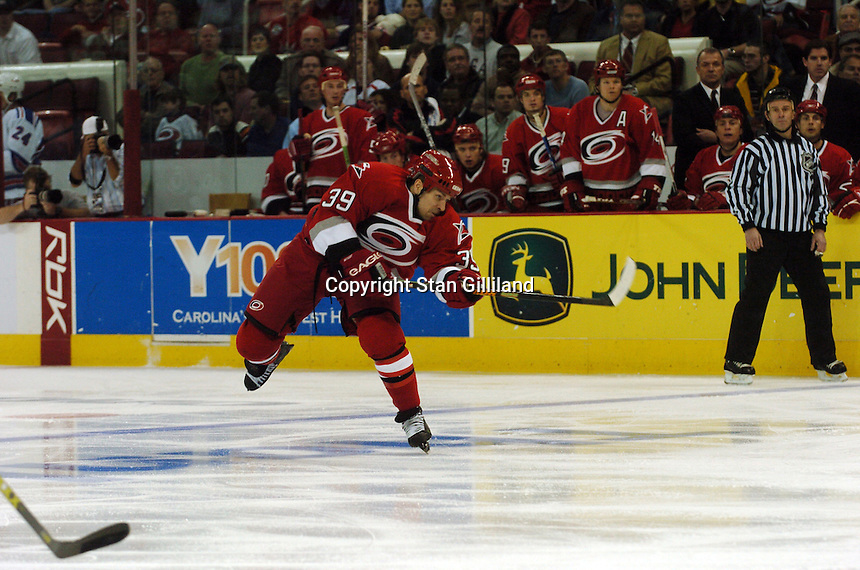 Carolina Hurricanes' Doug Weight shoots for his first goal as a Hurricane during a game with the New York Rangers Tuesday, March 14, 2006 at the RBC Center in Raleigh, NC. Carolina won 5-3.
