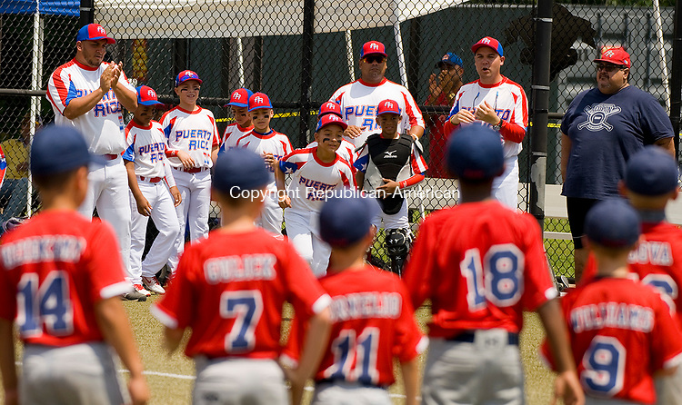 WATERBURY, CT-0712017JS05--Wolcott's players look on as Puerto Rico players are introduced prior to their Roberto Clemente World Series game Thursday at Municipal Stadium in Waterbury. <br /> Jim Shannon Republican-American