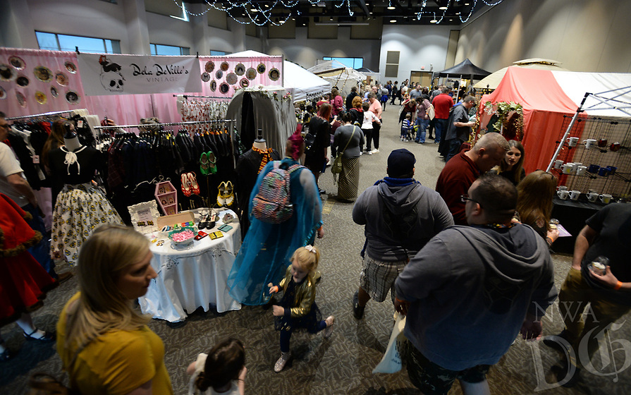 NWA Democrat-Gazette/ANDY SHUPE<br /> A large crowd gathers Saturday, March 23, 2019, during the Wizard Way of the Ozarks in the Fayetteville Town Center. The event features activities, performances, vendors and panel discussions, all benefitting the Arkansas Support Network's KidsClub which provides summer activities for kids with developmental disabilities. The festival continues from 10 a.m. to 6 p.m. today at the Town Center and the Chancellor Hotel.
