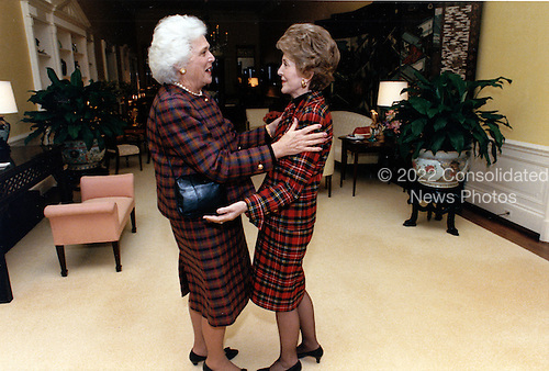 First lady Nancy Reagan, right, welcomes incoming first lady Barbara Bush, left, to the White House in Washington, DC before taking her on a tour of the private quarters on January 11, 1989.<br /> Mandatory Credit: Mary Anne Fackelman-Miner / White House via CNP