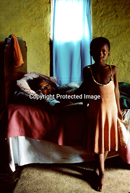 An unidentified young girl at her mother side on November 15, 1999 in Izingolweni, a rural village in Southern Natal province in South Africa. The mother is dying of Aids related disease. The only daughter will be taken care of by grand parents..(Photo: Per-Anders Pettersson/ Liaison Agency)