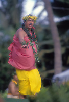 Kumu hula, Robert Cazimero, chanting and dancing hula at Lanikuhonua, Oahu