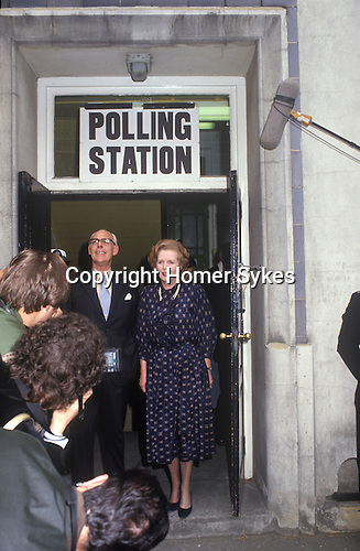 Mrs Maggie Margaret Thatcher and Denis Thatcher leaving their Polling Station having just voted in the 1983 General Election 1980s. Uk .