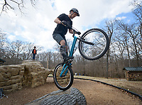 NWA Democrat-Gazette/BEN GOFF @NWABENGOFF<br /> Ryan Bratton of Bentonville practices his skills on Sunday Feb. 28, 2016 during a NWA Bike Trials group ride at Park Springs Park in Bentonville. Bratton heads the NWA Bike Trials group and recently gained sponsorship from Mojo Cycling in Bentonville.