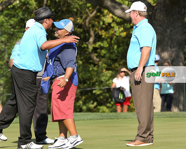 25 SEP 12   George Lopez with a high flying chest bump for caddie Mike Collins on the 5th green during Tuesdays Celebrity Scramble at The 39th Ryder Cup at The Medinah Country Club in Medinah, Illinois.