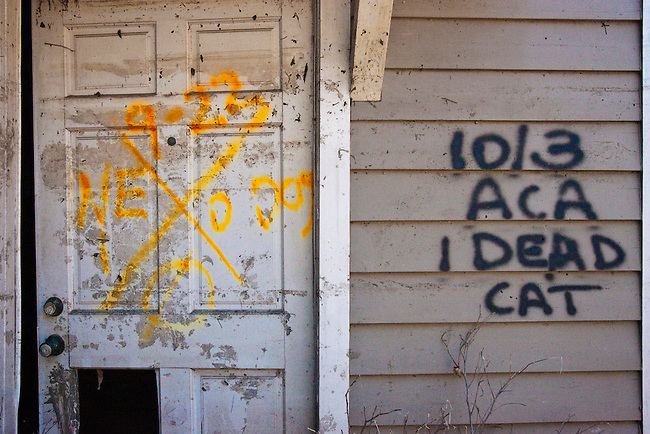 First responder search and rescue teams spray painted X-codes in bright colors on the doors of homes and other buildings as having been searched throughout flooded areas right after Hurricane Katrina in New Orleans, Louisiana. This home in the Lakeview area suffered major damage due to Hurricane Katrina flooding.