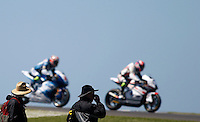 Spectators watch Moto2 riders during the first practice session of the Australian Motorcycle GP in Phillip Island, Oct 18, 2013. Photo by Daniel Munoz/VIEWpress. IMAGE RESTRICTED TO EDITORIAL USE ONLY