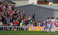 Cheltenham players celebrate their side's first goal, scored by Asa Hall during the Sky Bet League 2 match between Newport County and Cheltenham Town at Rodney Parade, Newport, Wales on 10 September 2016. Photo by Mark  Hawkins / PRiME Media Images.